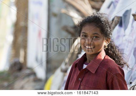 Illustrative image. Pondicherry Tamil Nadu India - Marsh 07 2014. Poor child with smile feeling in the street