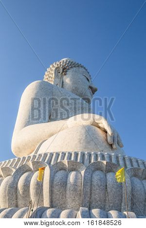 Perspective view from below of the popular Big Buddha on Nakkerd hills of Ao Chalong in Phuket, Thailand. Phuket's Big Buddha is one of the island's most important and revered landmarks on the island.