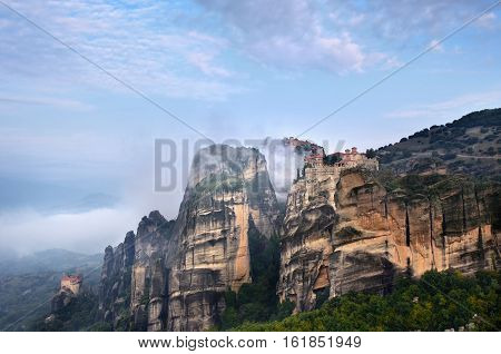 Meteora landscape. Beautiful view on the Holy Monasteries placed on the edge of high rock at sunrise Kastraki Greece.