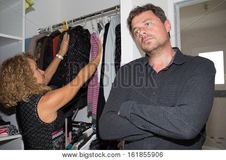 man waiting woman dressing room boring and be late