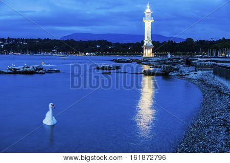 Geneva Lighthouse seen at night. Geneva Switzerland.