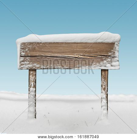 Wide Wooden Signpost With Snow And Blue Sky