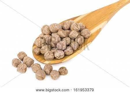 Bamboo Spoon With Extruded Rye Bran Isolated On White