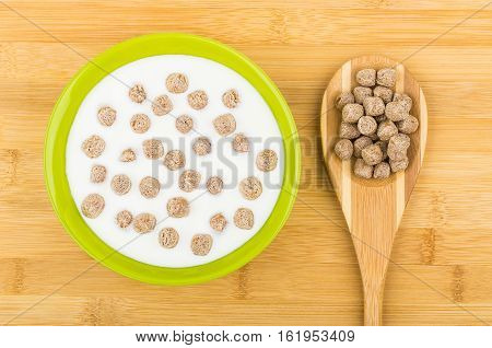 Bowl With Yogurt And Extruded Rye Bran And Bamboo Spoon