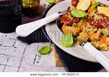 Salad with roasted vegetables and quinoa. Selective focus.