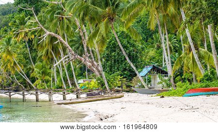 Wooden Pier of an local Village on Gam Island, West Papuan, Raja Ampat. Indonesia