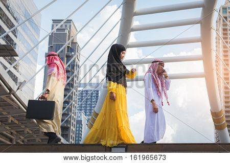 Two Young Muslim Business Man Holding Smart Phone And Bag And Walking Rapidly To Airport And Young M