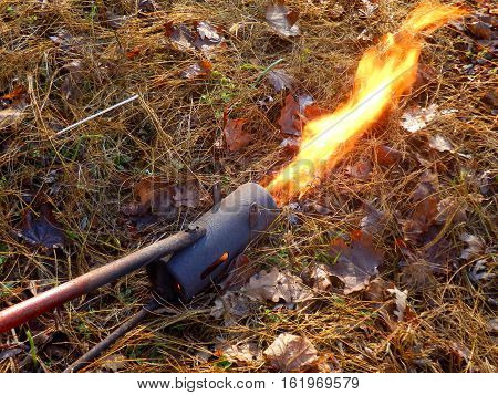 Flame gun/thrower after coil warming up and starting to throw the flame out of the front