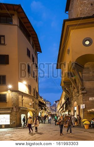 People Near Ponte Vecchio In Florence In Evening