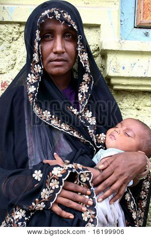 NEW DELHI, INDIA - Mother holding baby during religion celebration June 18, 2008 in New Delhi, India