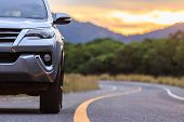 Close Up Front Of New Silver Suv Car Parking On The Asphalt Road poster