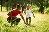 Sport Practice With Father Teaching Son How To Play Soccer poster