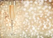 image of champagne glass  - Glass of champagne against golden background - JPG
