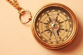 Antique Brass Compass Over Old Background poster