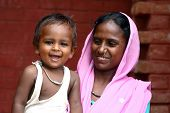 happy woman with boy - India