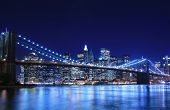 stock photo of new york skyline  - Brooklyn Bridge and Manhattan skyline At Night New York City - JPG