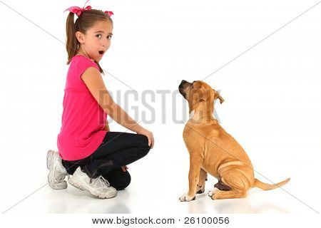 Adorable seven year old american girl with boxer puppy over white.