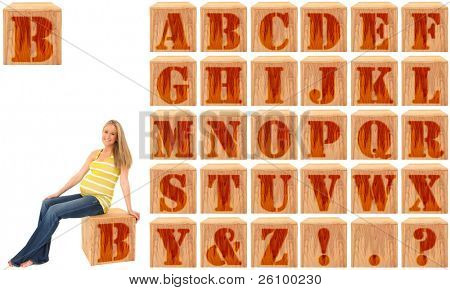 Wood engraved and stained alphabet blocks.  Featuring pregnant woman on Letter B.