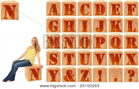 Wood engraved and stained alphabet blocks.  Featuring pregnant woman on Letter N.