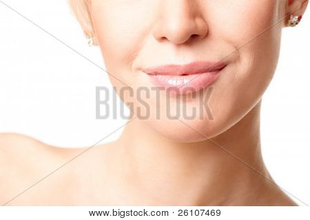 Beautiful young woman's face fragment with natural smile. Isolated on white