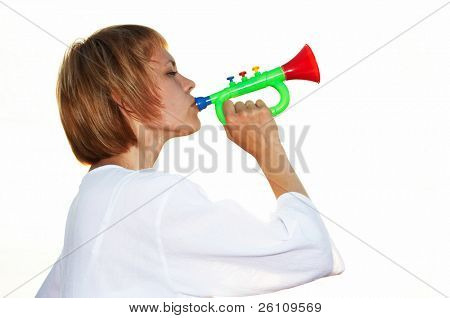 young girl play horn on white