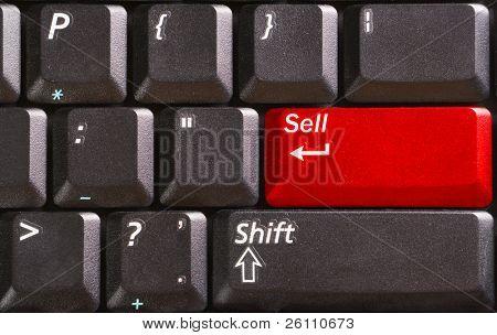 teclado negro con la palabra vender en botón rojo
