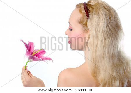 pretty blonde girl with pink lily on white background