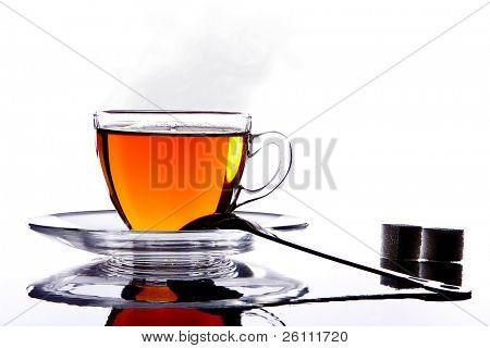 silhouette glass hot cup of tea an sugar