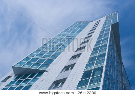 Office business building on a background of the blue sky