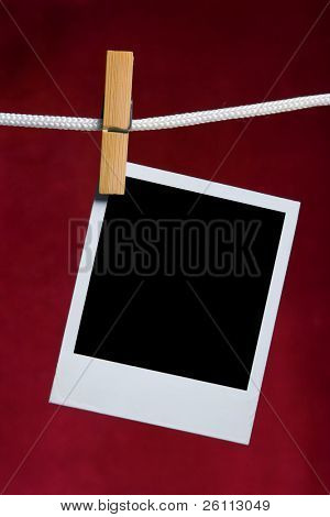old photo frame attach to rope clothes peg on red