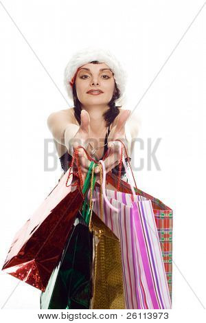 beauty shopping girl in santa red cap with gift on white