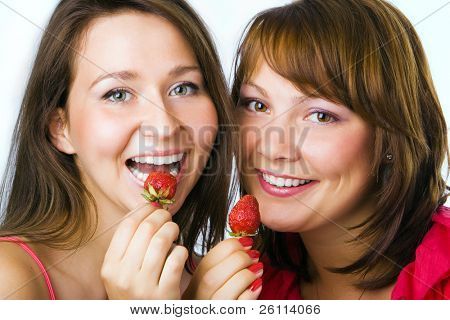 happy couple woman eat strawberry on white