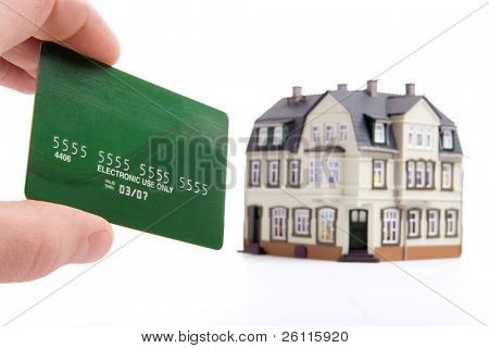 hand and plastic card payment for the house over white background