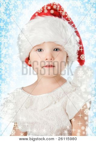 pretty baby in santa claus christmas red hat and snowflake
