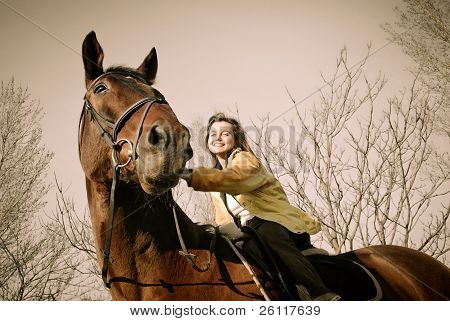 Woman Riding On Big Browm Horse