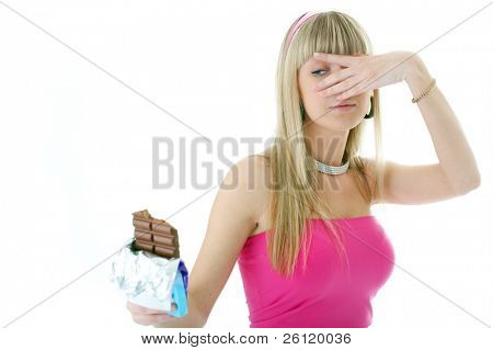 woman look on  chocolate through fingers on white background