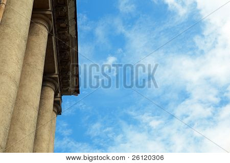 column construction under blue sky with clouds