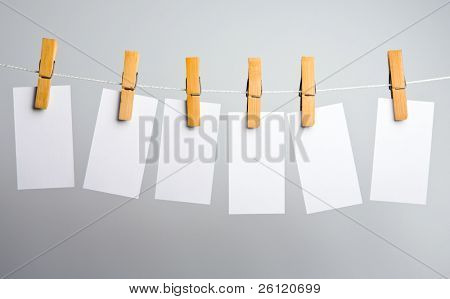 white paper blanks on rope attach clothes-peg