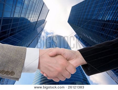 handshake on business glass buildings background
