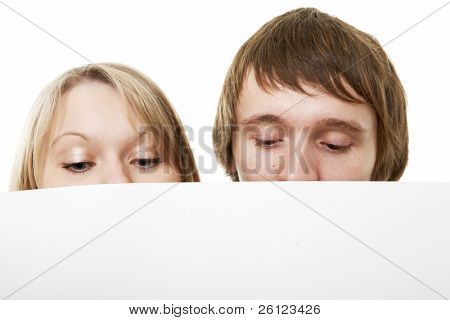 two young business people show white sign on white background
