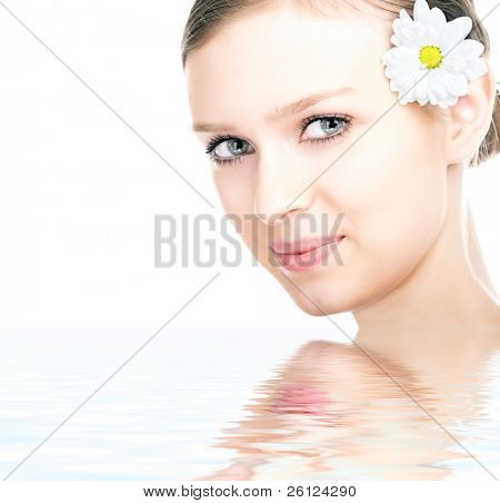 beauty woman portrait with camomile flower on white background