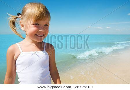 little girl child on coast of sea