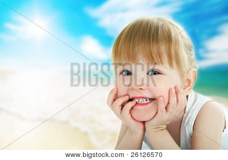 child on beach under sun
