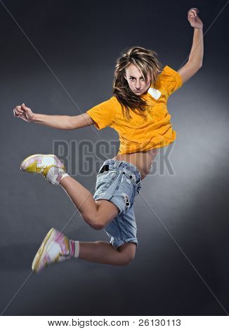 cool dancer woman on gray background