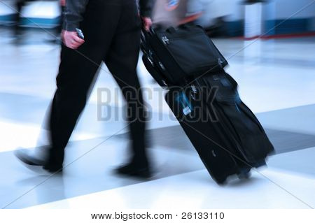 Man rushing through an airport terminal