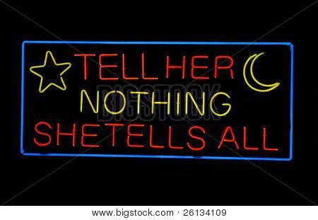 "Psychic's ""Tell Her Nothing - She Tells All"" neon sign"