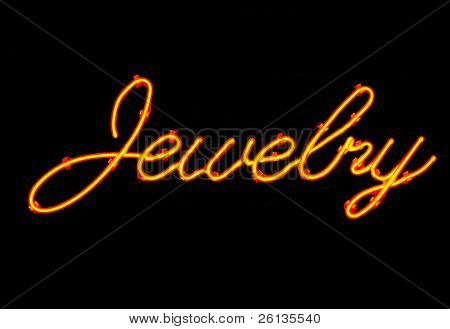 Red jewelry neon sign isolated on black background