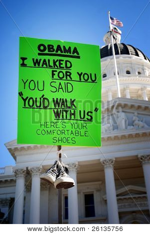 "SACRAMENTO, CA - FEBRUARY 26: Protest sign at the California State Capitol recalls President Barack Obama's promise to ""walk with"" labor unions on February 26, 2011 in Sacramento, CA."