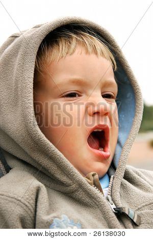 yawning baby-boy partly isolated over white