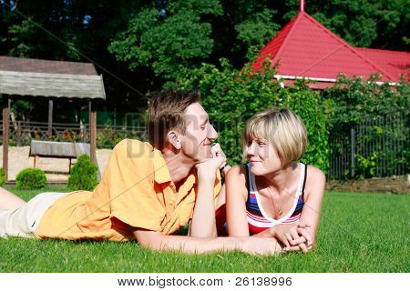 young couple laying on grass